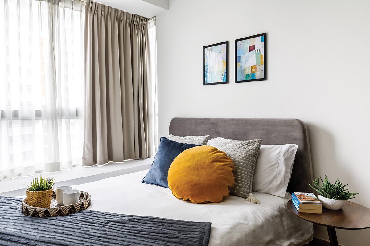 squarerooms home philosophy mid century modern contemporary design makeover style look resale condominium bedroom white cosy minimalist orange yellow