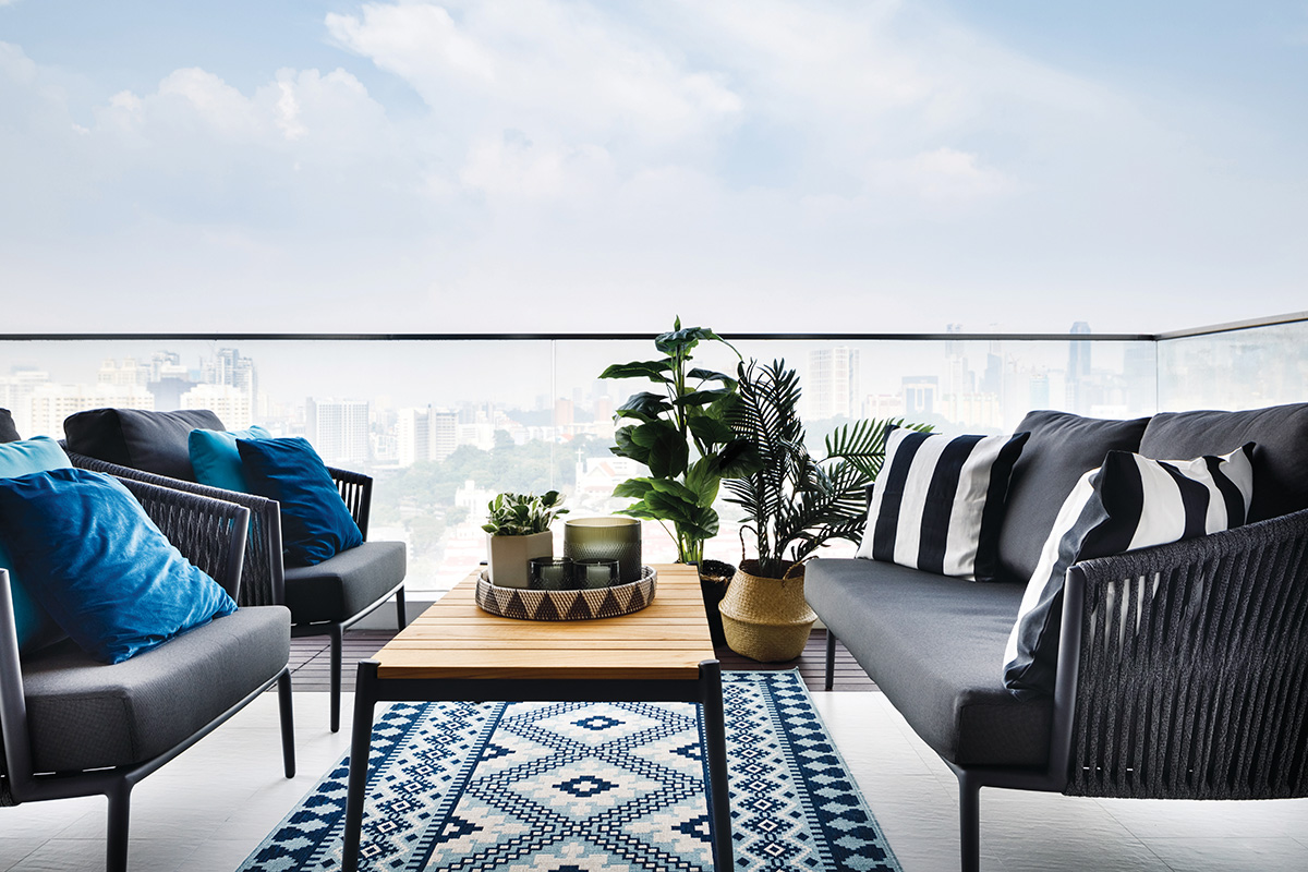 squarerooms home philosophy mid century modern contemporary design makeover style look resale condominium balcony seating chairs rug comfy