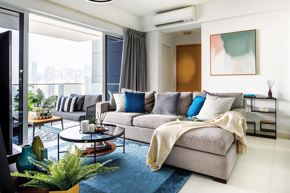 squarerooms home philosophy mid century modern contemporary design makeover style look resale condominium living room blue cream beige sofa
