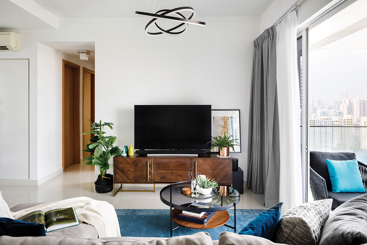 squarerooms home philosophy mid century modern contemporary design makeover style look resale condominium living room wood tv console blue rug