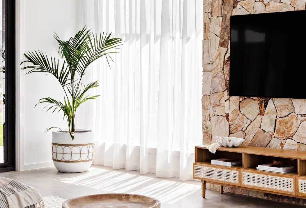 Oak and Orange The Palm Co living room rock wall feature tv neutral minimalist desert style warm