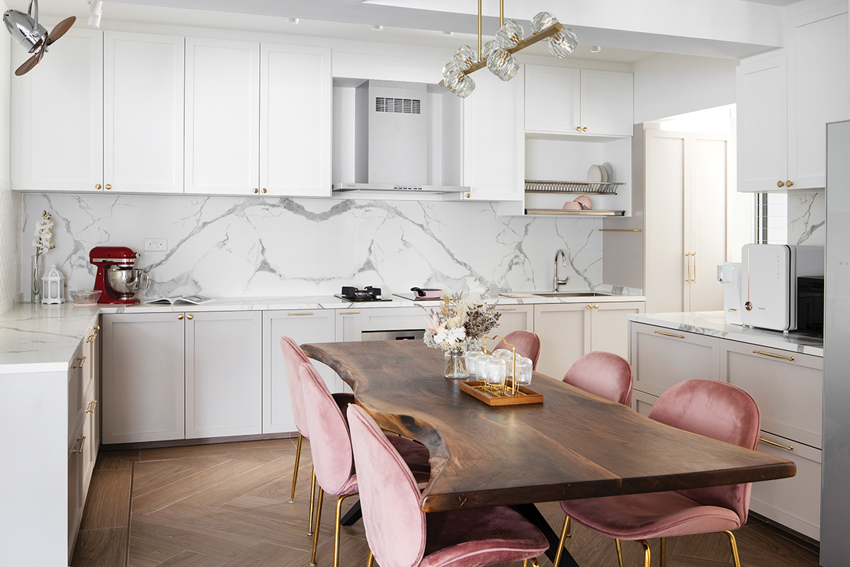 squarerooms fifth avenue interior design home makeover renovation contemporary pink and white cute soothing relaxing feminine parisian paris inspired 5 room hdb flat dining room kitchen open space concept chairs luxury luxurious luxe elegant marble backsplash wood live edge slab
