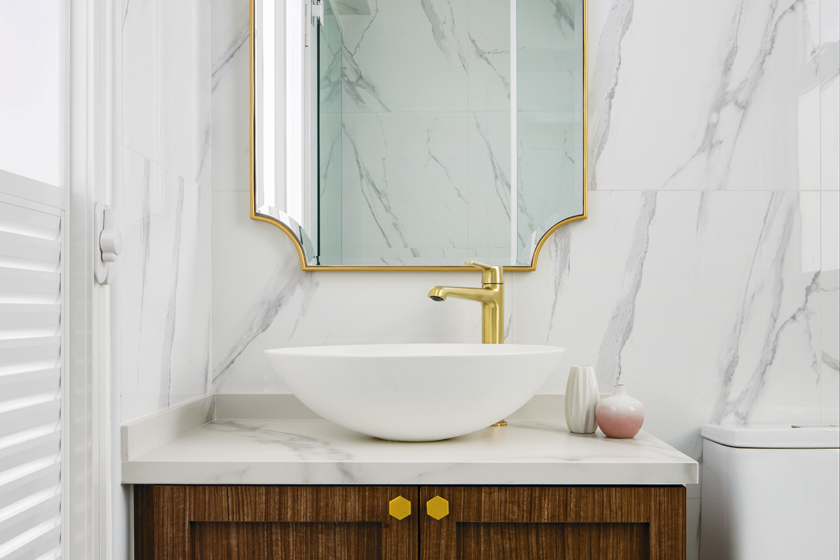 squarerooms fifth avenue interior design home makeover renovation contemporary pink and white cute soothing relaxing feminine parisian paris inspired 5 room hdb flat bathroom gold mirror marble tiles wood vanity cabinet sink countertop
