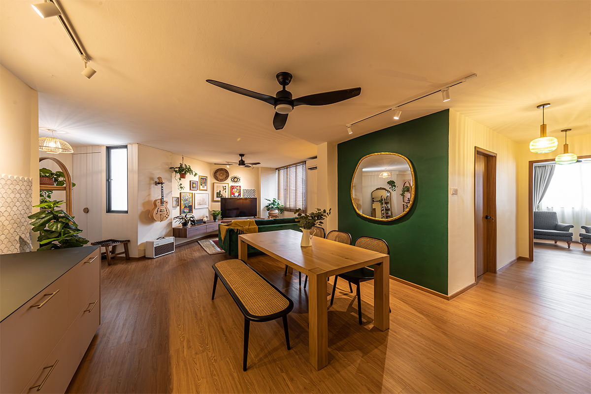 squarerooms swiss interior home renovation 4A 4 room hdb resale flat eclectic style design look makeover cosy living dining room area open space concept green feature wall mirror warm inviting wood floors