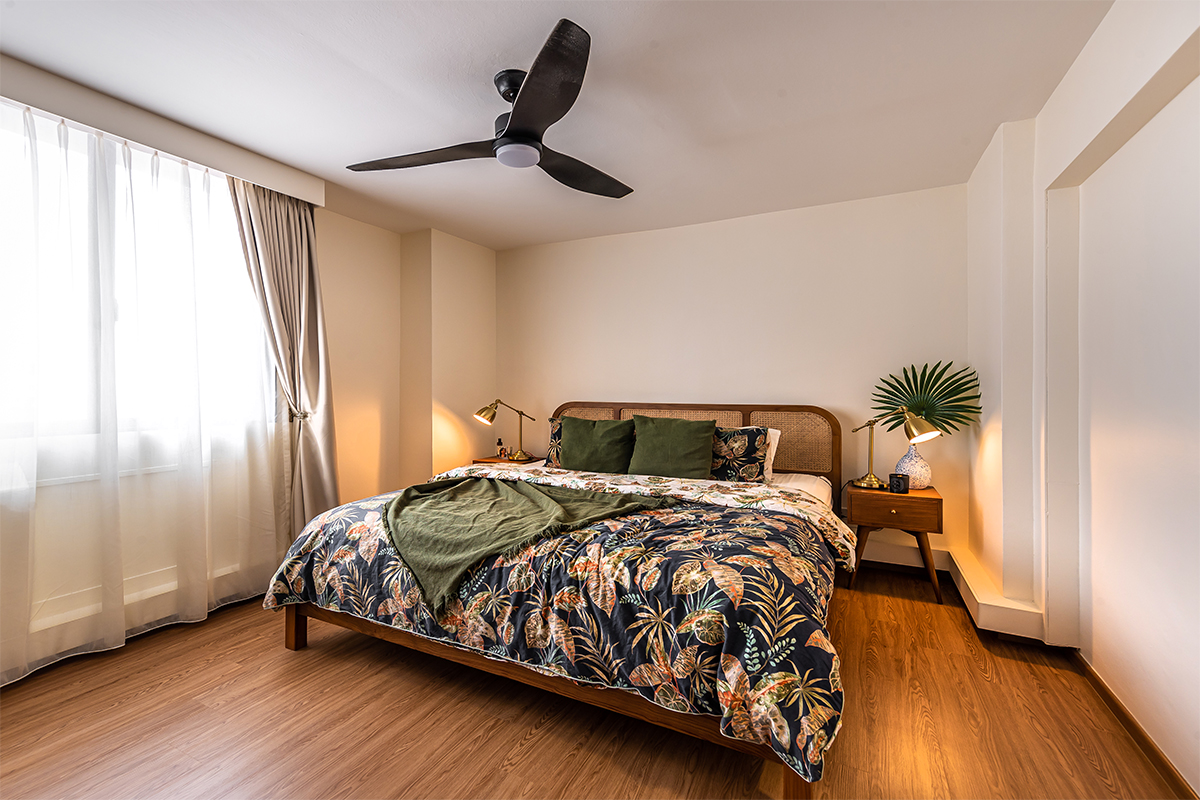 squarerooms swiss interior home renovation 4A 4 room hdb resale flat eclectic style design look makeover cosy bedroom bedding sheets tropical botanical leaves wood floors