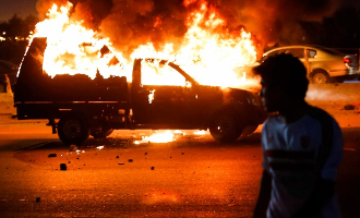 Vehicles were burned during clashes between football fans and police outside Air Force Stadium before the Egyptian Premier League match between Zamalek and ENPPI