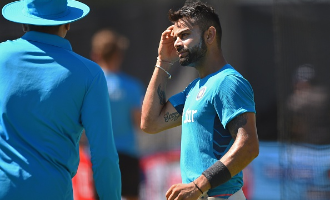 Kohli in the eye of storm after row with journalist