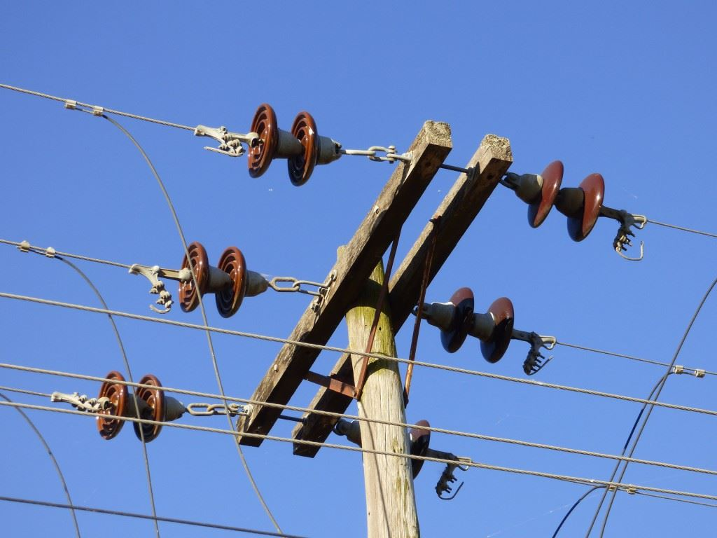 Electrical insulators properties of electrical insulators for Glass power line insulators