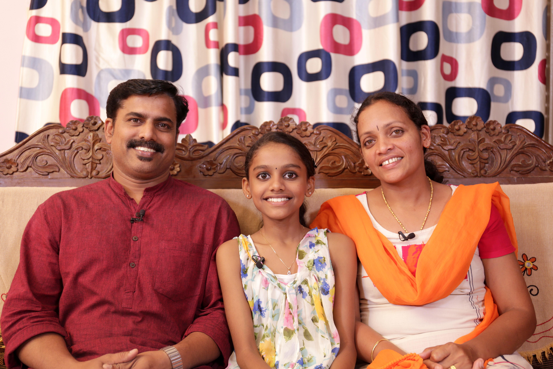 Devananda with her parents