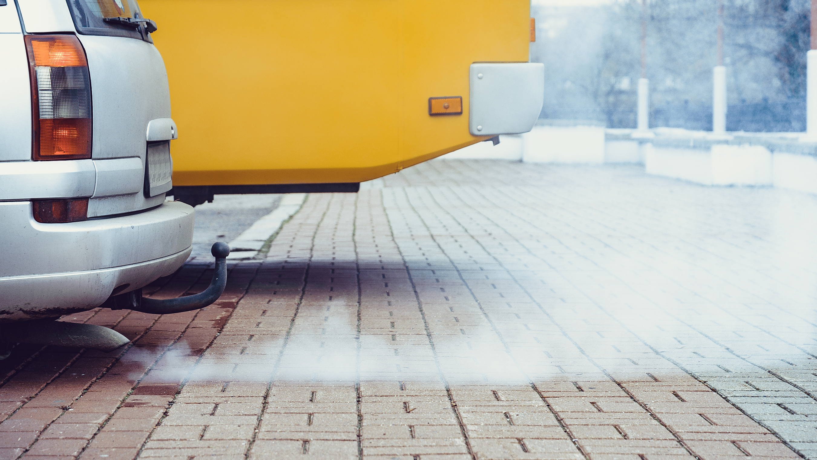 Polluting carbon emissions from the tailpipe of a non-electric vehicle