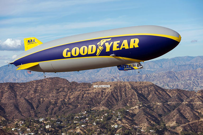 The Goodyear blimp flies over Hollywood hills