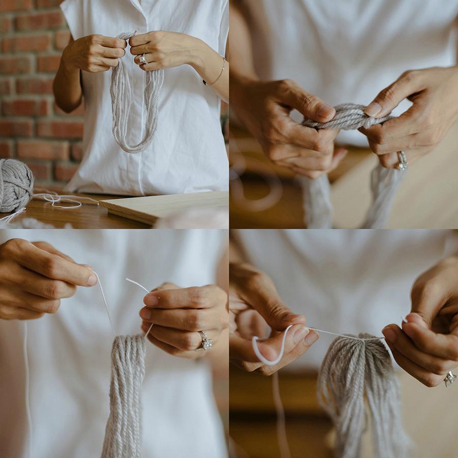 07-DIY-Yarn-Tassle-Wedding-Backdrop