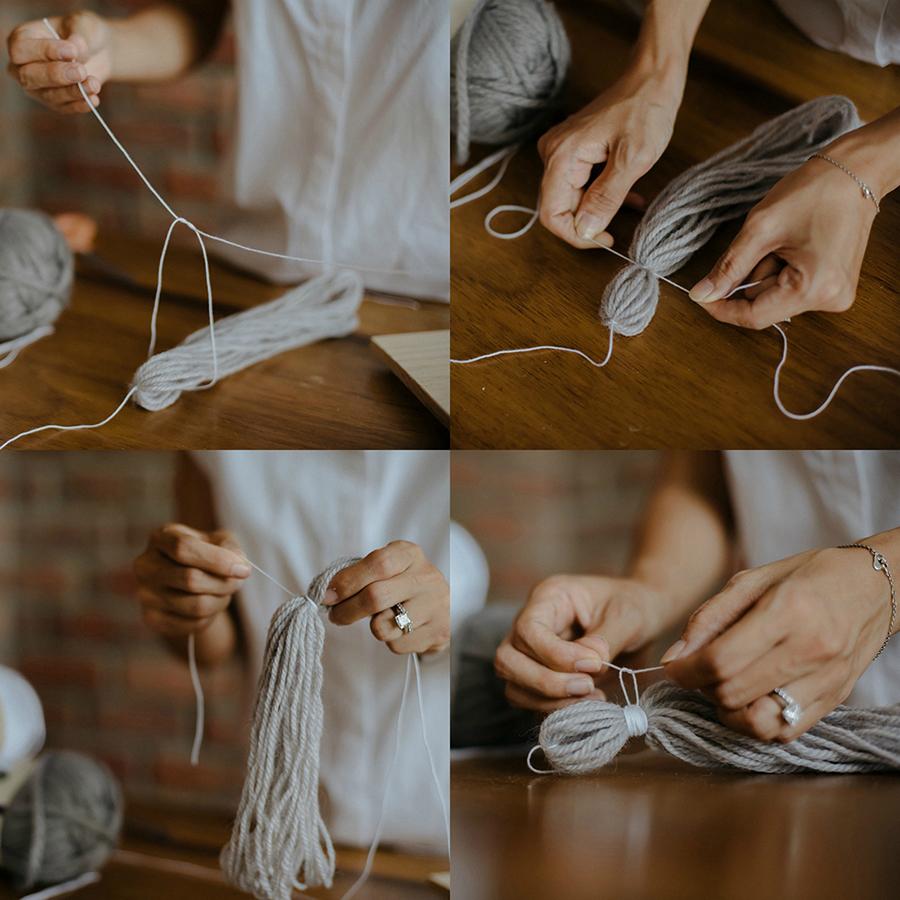 10-DIY-Yarn-Tassle-Wedding-Backdrop