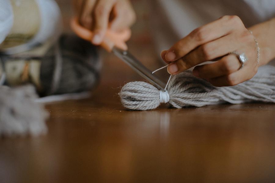 11-DIY-Yarn-Tassle-Wedding-Backdrop
