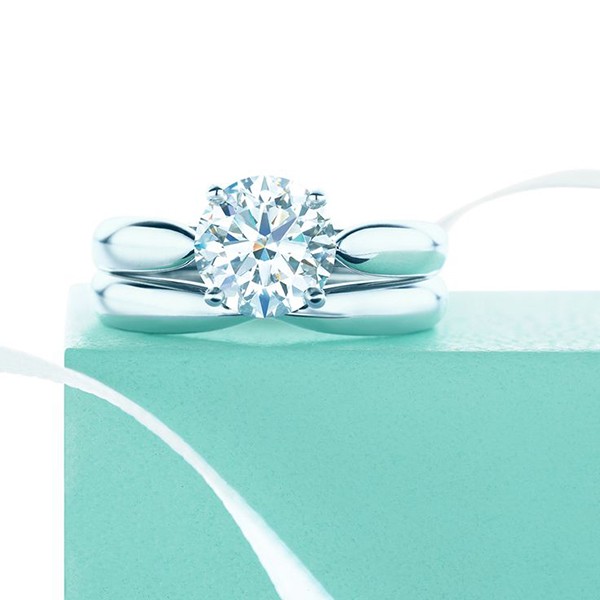 9e9c19a09 Tiffany's Harmony engagement ring comprises a round, brilliant-cut diamond  set on a tapered platinum band. What we love about this is that a matching  ...