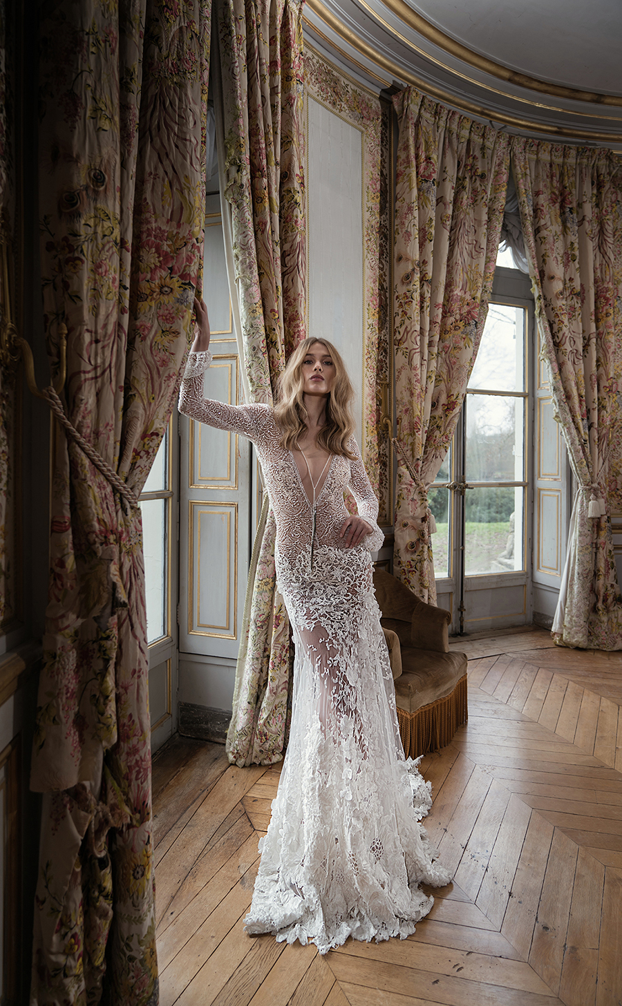 36e924679159e0 Dimensional lace V gown with appliqued skirt and attached lariat beaded  necklace and long crochet lace sleeves