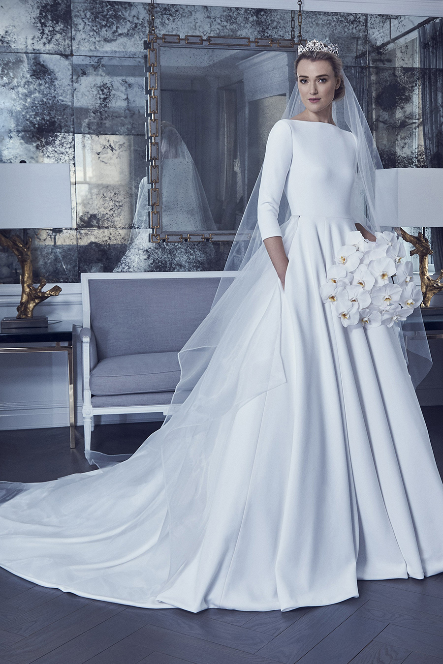 23e171d197b6 Pearl gown made of stretch silk crepe featuring a three-quarter sleeve boat  neck bodice and a ball gown skirt, accented with covered buttons to end of  train