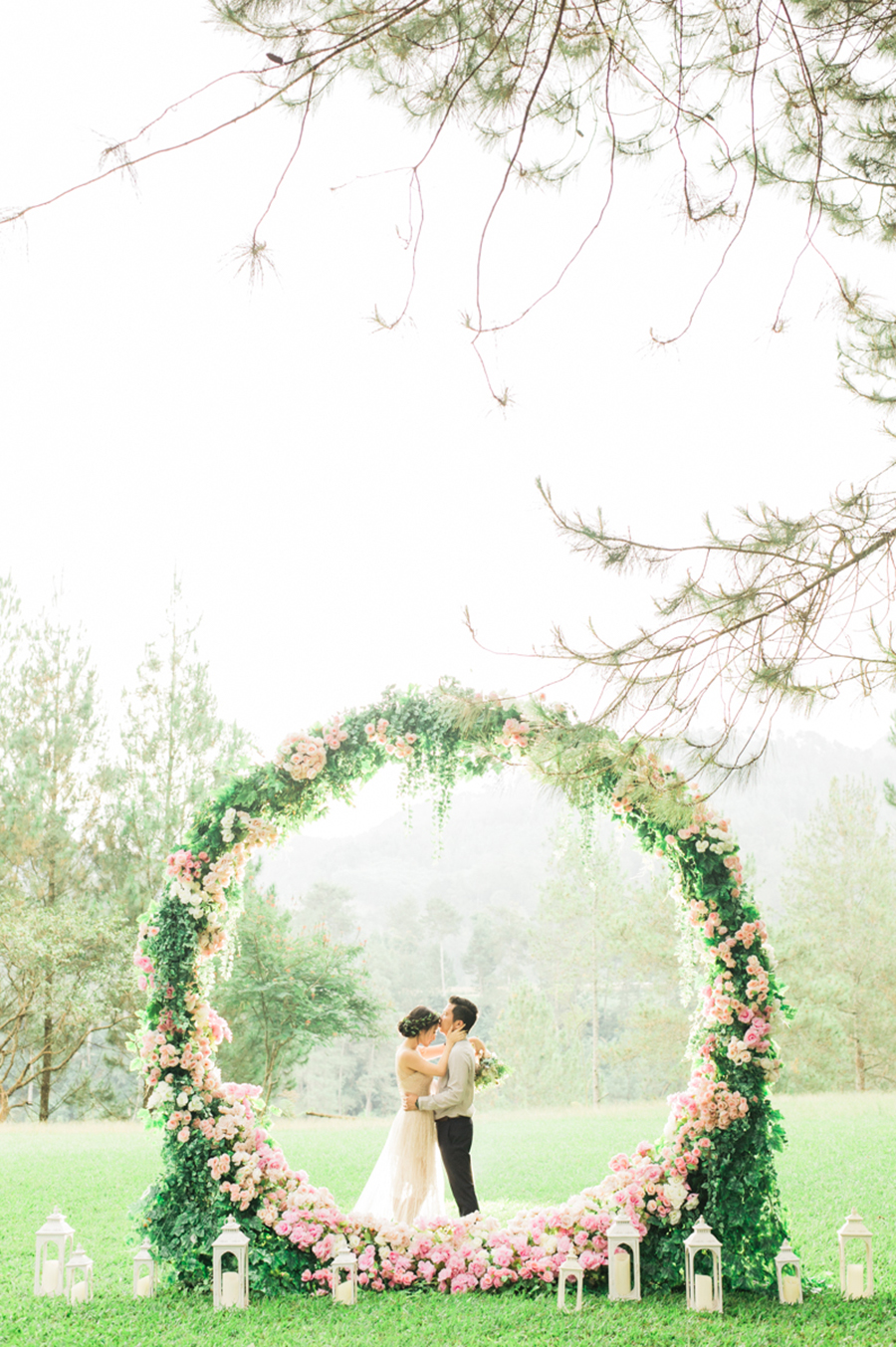 The wedding scoop dcor and flowers by trinity artwork bouquet by chloe florist photography by the wagyu story via gerry and devinas engagement with a giant floral wreath junglespirit Choice Image