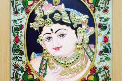 Emboss a reverse glass painting on a tanjore painting