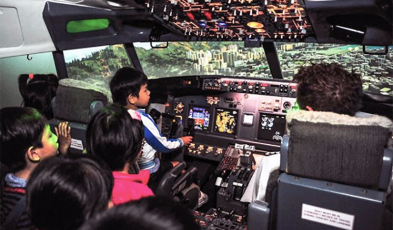 kids in the flight simulator