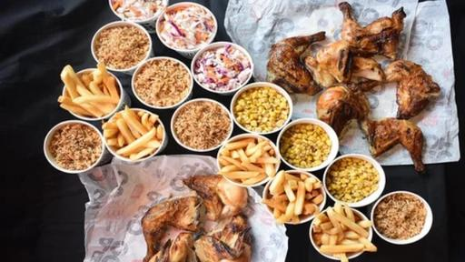 Chicken Bundle: 3x Large Grilled Corn, 3x Large Crunchy Slaw, 5x Large Chips, 5x Large Spicy Rice, 5x 1/4 Lemon and Herb Chicken, 5x 1/4 Chilli Chicken