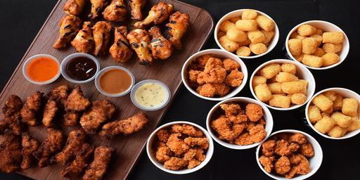 Snack Bundle: 12pcs Crispy Chicken Strips, 12 pcs Spicy Drumlet, 4x Large Spicy Bolas, 4x Large Potato Bites and your choice of 4 sauces