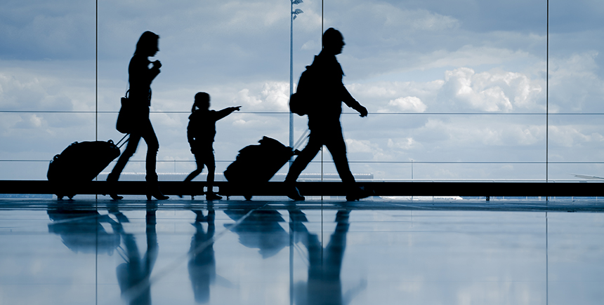 Silhouette of a family at the airport