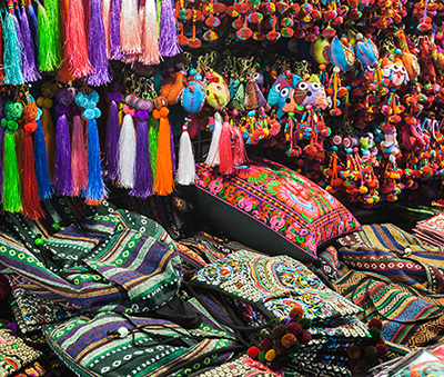 Colorful fabrics and keychains at a market