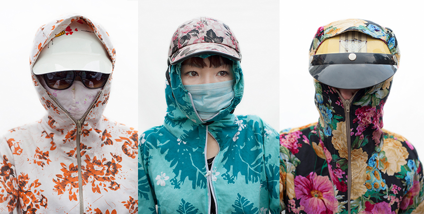 These female scooter riders in Hanoi cover up to protect themselves from the sun