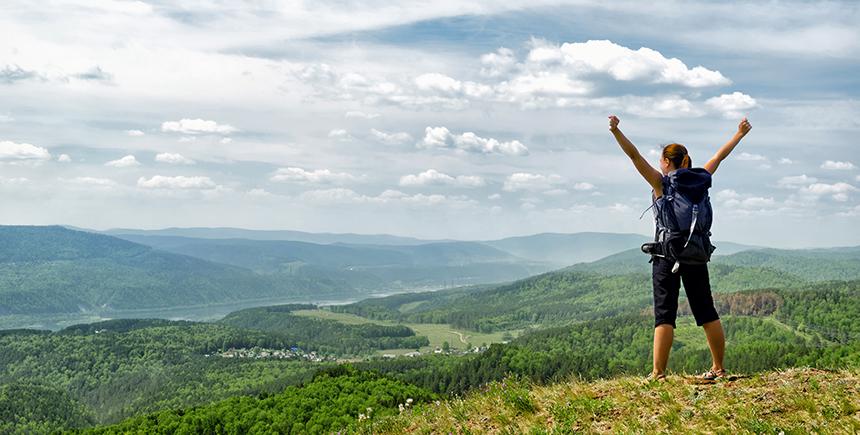 A female backpacker on a hill