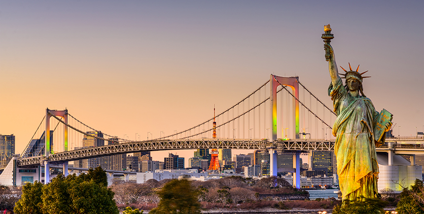A replica of the Statue of Liberty in Odaiba, with the Rainbow Bridge in the background