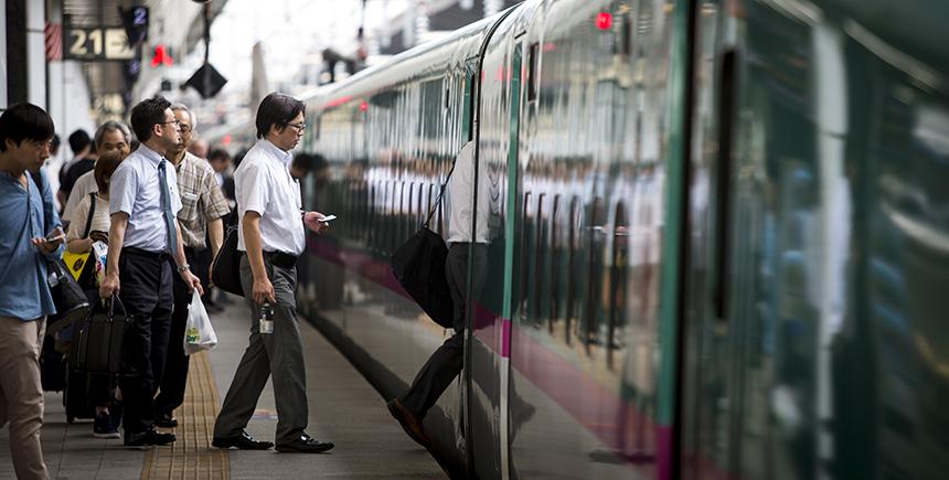 Passengers board an E5 Series Shinkansen
