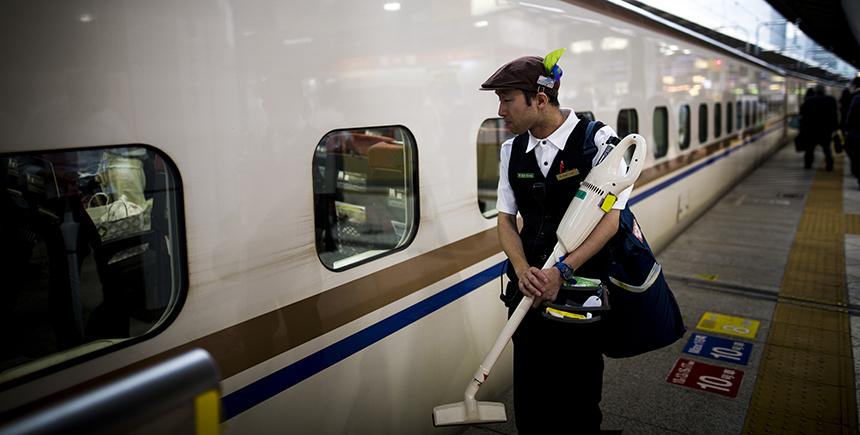 A cleaning service staff works on the Hokuriku