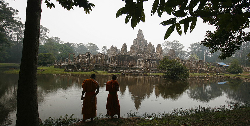 Two Buddhist monks at Bayon, one of Angkor Thom's major temples