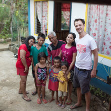 Tom with residents of one of the GK villages he works with (Photo: Richard Rigby)