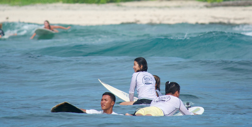 Surf students and instructors test the waves