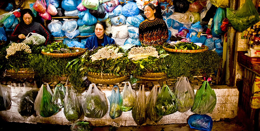 Vendors hawking fresh vegetables at the market