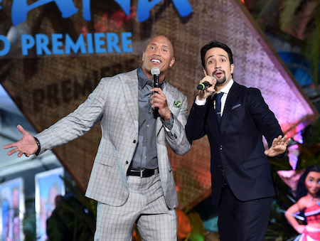 """HOLLYWOOD, CA - NOVEMBER 14:  Actor Dwayne Johnson (L) and songwriter Lin-Manuel Miranda perform onstage at The World Premiere of Disney's """"MOANA"""" at the El Capitan Theatre on Monday, November 14, 2016 in Hollywood, CA.  (Photo by Alberto E. Rodriguez/Getty Images for Disney)"""