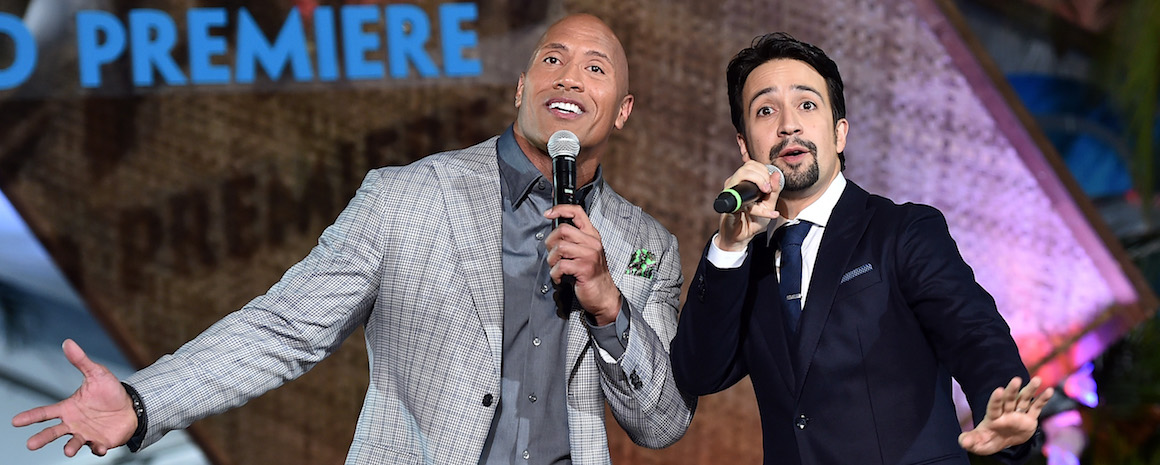 "HOLLYWOOD, CA - NOVEMBER 14:  Actor Dwayne Johnson (L) and songwriter Lin-Manuel Miranda perform onstage at The World Premiere of Disney's ""MOANA"" at the El Capitan Theatre on Monday, November 14, 2016 in Hollywood, CA.  (Photo by Alberto E. Rodriguez/Getty Images for Disney)"