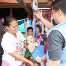 Health workers use a MUAC tape to check children for signs of malnutrition. UNICEF works with partners and government to provide Infant and Young Child Feeding counselling sessions typhoon Yolanda affected areas. As families are now moving to transition sites or back home, work is shifting to the community level, with UNICEF building capacity of partners on the ground to deliver micronutrient supplementation, deworming, screening and referral for children with acute malnutrition.