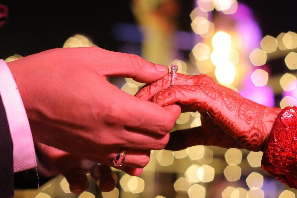 Engagement rings of bride & groom
