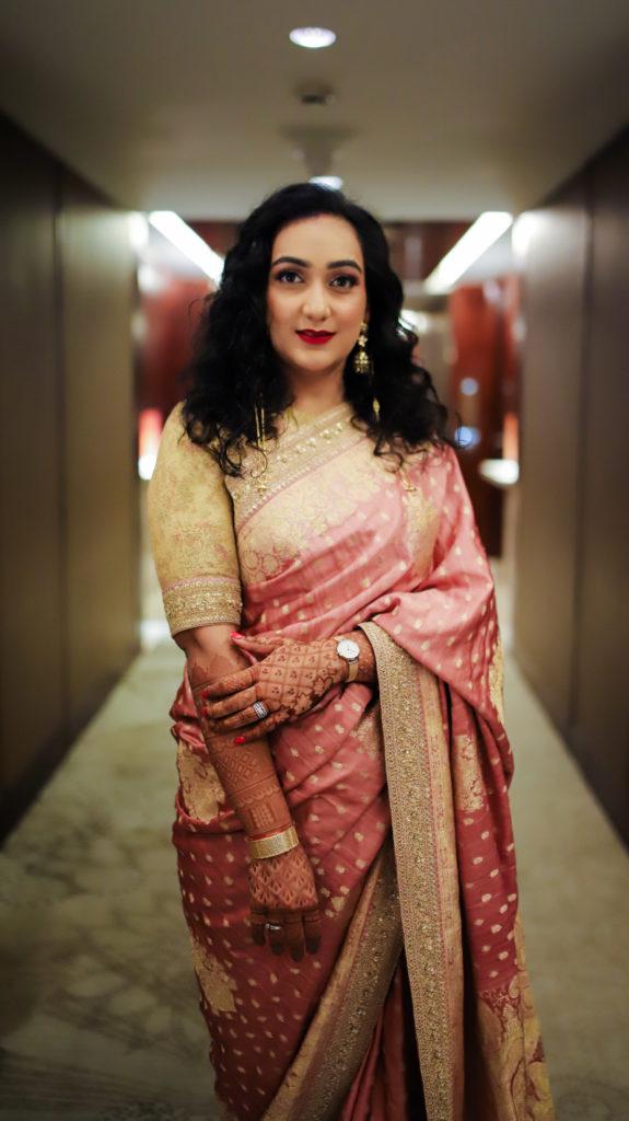 Bride in Sabyasachi saree for wedding reception