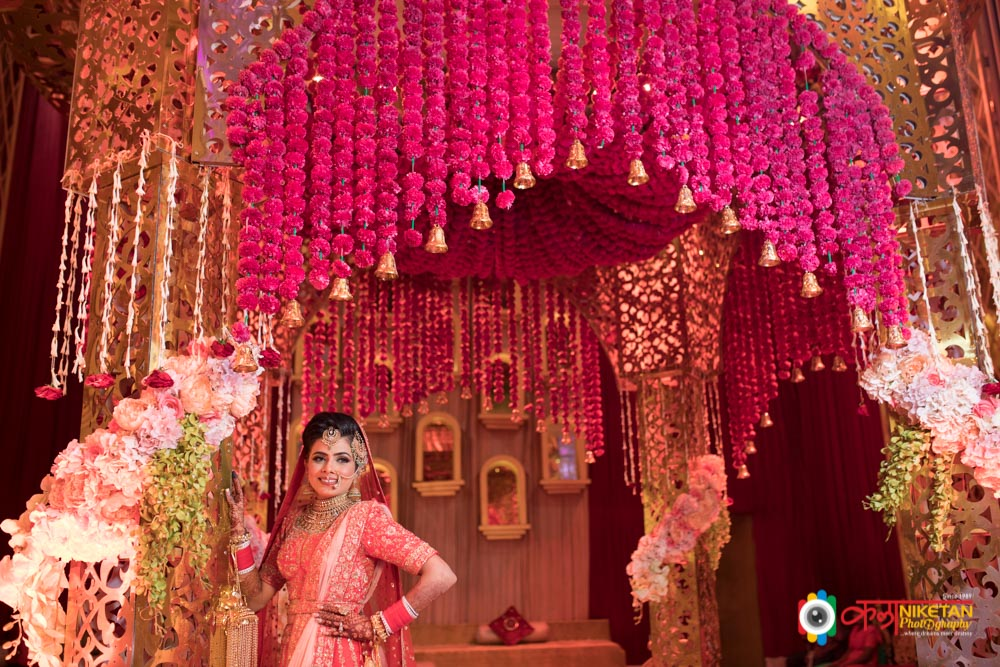Bride in a Coral Pink Lehenga