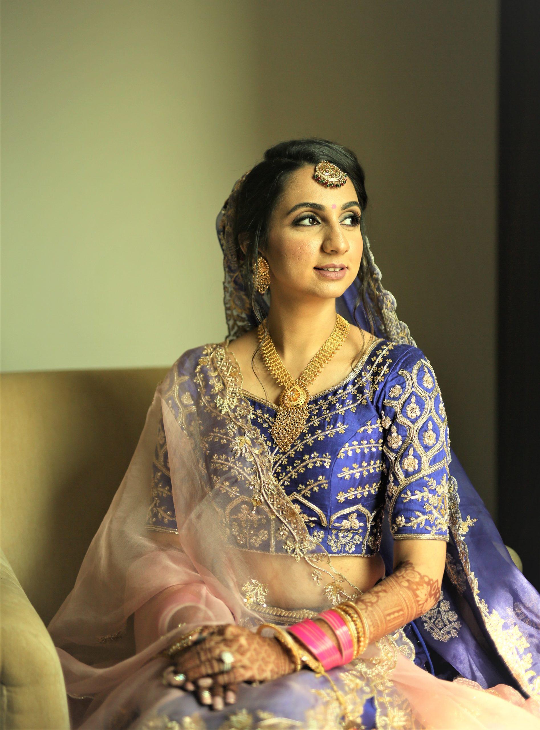 Indian bride in royal blue lehenga