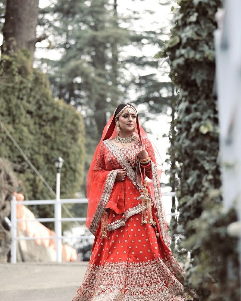 Indian bride in red lehenga for her wedding in Shimla