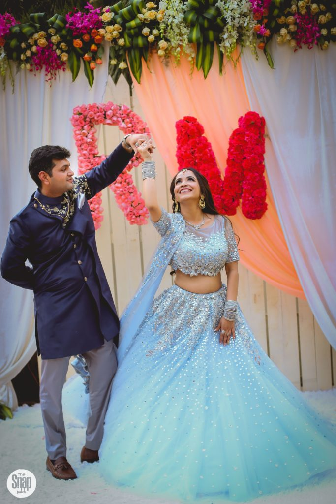 Delhi bride & groom in coordinated blue outfits for Sagan & Sangeet ceremony