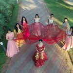 Indian bride in red lehenga for her beach wedding in Goa