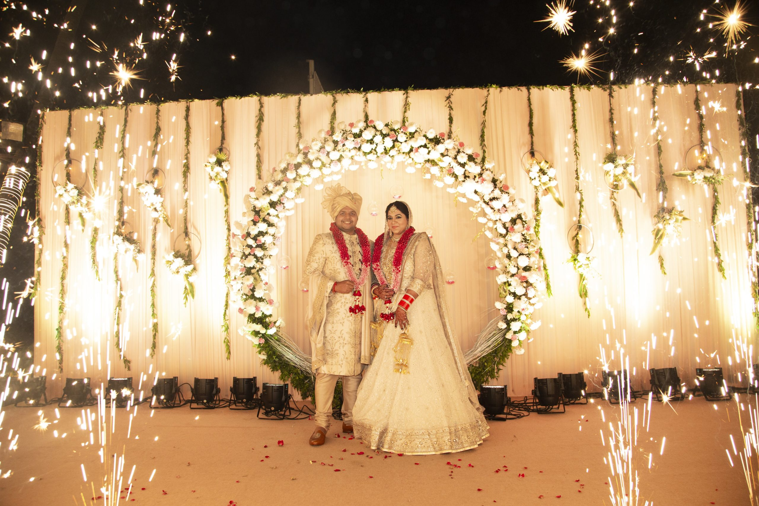 bride & groom in ivory colored outfits