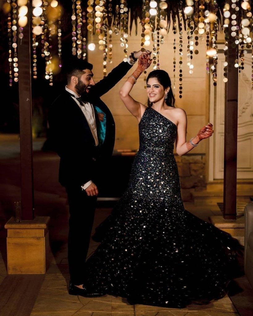 Bride in black bridal gown & groom in black tuxedo