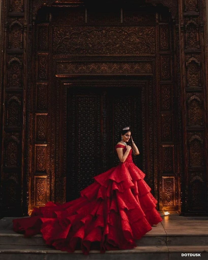Bride in red princess gown with train for her Cocktail night